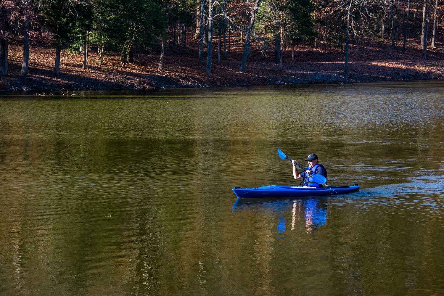 Kayaker on Lake Wylie near South shore in McLean