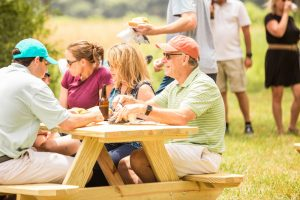 Guests enjoy a picnic beside Lake Wylie